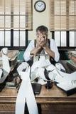 Retro desperate accountant head in hands Stock Photography