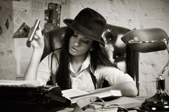 Retro detective in the detective agency Stock Images