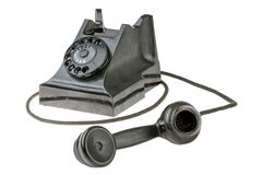 Retro dial-up rotary telephone. With the handset lying in the foreground turned towards the camera on a white studio background royalty free stock photography