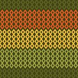 Retro Diamond Chevron Seamless Pattern. Geometric diamond shapes and chevron seamless pattern in vintage colors of orange, yellow, and green inspired by 1970s Royalty Free Stock Images