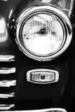 Retro dichte omhooggaand van de autokoplamp stock afbeelding