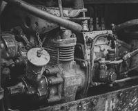 Retro diesel motor of tractor. Black and white photo