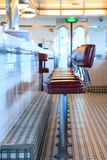 Retro Diner. An empty diner awaits its first customers of the day Royalty Free Stock Photo