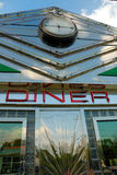 Retro diner. Fifties retro diner sign on chrome frontage under blue sky - vintage Americana royalty free stock images