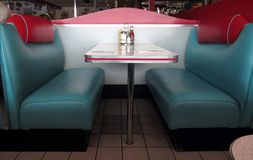 Retro Diner Booths. These turquoise and red leather booths at the diner take us back to the '50s Royalty Free Stock Images