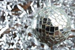 Retro disco ball. Retro disco ball on a silver background. Copy space Stock Image