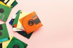 Retro disketter på rosa bakgrund Royaltyfria Bilder