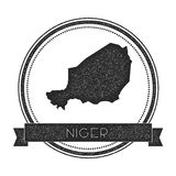 Retro distressed Niger badge with map. Royalty Free Stock Image
