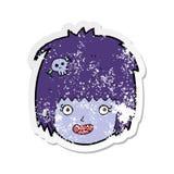 Retro distressed sticker of a cartoon happy vampire girl face. Illustrated retro distressed sticker of a cartoon happy vampire girl face royalty free illustration