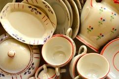Retro doll's tea set made of white porcelain. Set of vintage toys. Stock Photos