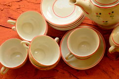 Retro doll's tea set made of white porcelain. Set of vintage toys. Royalty Free Stock Image