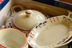 Retro doll's tea set made of white porcelain. Set of vintage toys. Stock Photo
