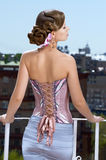 Retro dressed woman. Woman styled in a retro way standing on the balcony royalty free stock image