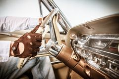 Retro Driver in Leather Gloves royalty free stock image