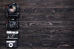 Retro and DSLR camera. Stock Photos