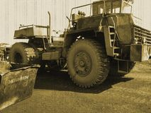 Retro dump truck, aged photo, truck for scrap. Old car royalty free stock photos