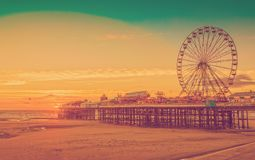 Retro Effect Photo Filter: Blackpool Central Pier and Ferris Wheel, Lancashire, England, UK.  Royalty Free Stock Image
