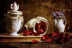Retro effect on photo vintage tea with rose dry petal Royalty Free Stock Photography
