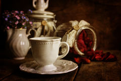 Retro effect on photo vintage tea with rose dry petal Royalty Free Stock Images