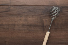 Retro egg whisk with wooden handle Royalty Free Stock Photography