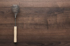Retro egg whisk with wooden handle Royalty Free Stock Images