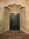 Retro elaborate wood doors and fancy wall and steps Stock Images
