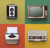 Retro electronics set. Retro or vintage set of electronics on color background royalty free stock photo
