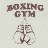 Retro emblem with old boxing gloves Stock Image