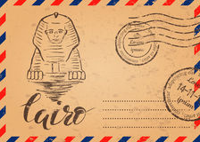 Retro envelope with stamps, Cairo label with hand drawn Sphinx, lettering Cairo. Vector illustration, Retro envelope with stamps, Cairo label with hand drawn Stock Images