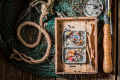 Retro equipment for fishing with fishing flies and rods Royalty Free Stock Photos