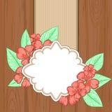Retro etichetta sopra legno marrone con i fiori e le foglie rossi Fotografia Stock