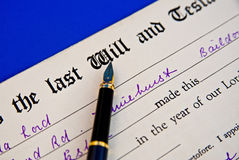Retro example of Last Will and Testament. A macro image of the form to be completed as the last Will and Testament together with fountain pen and excerpts of stock image
