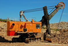 Retro excavator. Excavator in open cast mining quarry Stock Photo