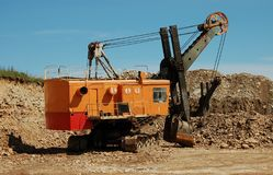 Retro excavator. In open cast mining quarry Royalty Free Stock Photo