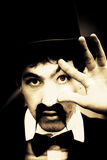Retro Eye Spy. Evil Black And White Portrait Of Scary Retro Style Man With Top Hat, Handlebar Moustache And Red Eye Spying In A Retro Eye Spy Vision Stock Photography