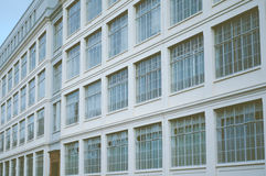 Retro Factory Building Exterior. Vintage Factory Building Windows Background Stock Photos