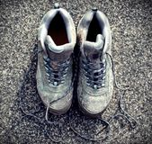 Retro Faded Photo Of Dirty Walking Boots on Sidewalk Royalty Free Stock Images