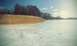 Retro faded and styled picture of a frozen lake Royalty Free Stock Images