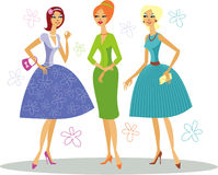 Retro fashion. Three fashionably dressed retro women Stock Images