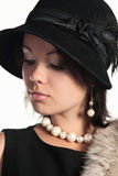 Retro fashion. Stylish woman in retro hat and white jewellery Royalty Free Stock Photography
