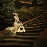 Retro fashion. Fairy tale. Beautiful dark-haired girl. Old fashion story. Fairy tale and legend. Grain added Stock Photo
