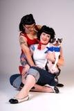 Retro fashion girls and dog. Royalty Free Stock Images