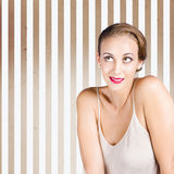 Retro fashion model looking at copyspace. Beautiful elegant fashion model with set fifties brunette hairstyle wearing chic make-up while looking up to beauty Royalty Free Stock Images