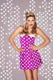 Retro fashion model in polka dot dress Stock Photos