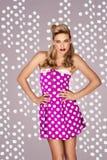 Retro fashion model in polka dot dress Stock Photos