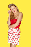 Retro fashion model in red polka dots Stock Photography