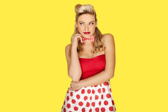 Retro fashion model in red polka dots Stock Photos