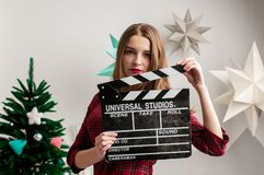 Retro-fashioned model is posing in artistic lights. Bright colors in the background stock image