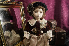 Retro fashioned porcelain doll. Stock Images