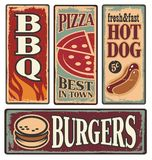 Retro fast food tin signs. Vintage fast food tin signs. Retro metal signs collection with pizza, burger, hot dog and barbecue. Delicious food backgrounds and Royalty Free Stock Image